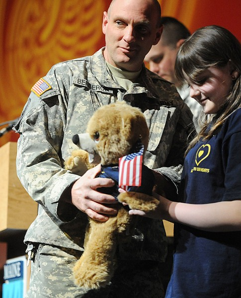 SSgst Dale Bergeron of glenburn is presented with a teddy bear by his daughter Jacqui during the Sendoff Ceremony for the Maine Army National Guard 1136th Transportation Company Saturday in Orono.  The 175 soldiers of the 1136th leave Bangor Sunday morning for a one year deployment to conduct force protection operations in Afghanistan. BANGOR DAILY NEWS PHOTO BY GABOR DEGRE