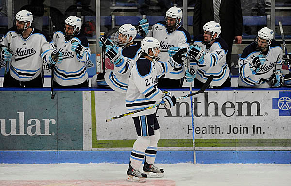 U Maine's Will O'Neill (#27) gets high-fived by teammates after scoring U Maine's first goal during the second period of U Maine's third Hockey East quarterfinal series game with U Mass-Lowell at Alfond Arena Sunday night, March 14, 2010. (Bangor Daily News/John Clarke Russ)