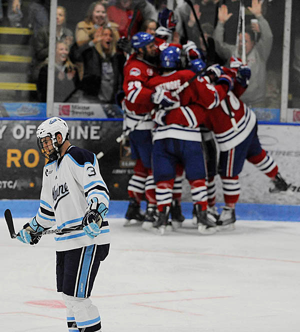U Maine's Mark Nemec (#3) reacts after the UMass Lowell piles around Colin Wright after he scored the team's first goal during the second period of U Maine's third Hockey East quarterfinal series game with U Mass-Lowell at Alfond Arena Sunday night, March 14, 2010. (Bangor Daily News/John Clarke Russ)