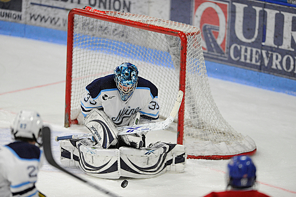 U Maine goalie Dave Wilson makes a save in the second period of U Maine's third Hockey East quarterfinal series game with U Mass-Lowell at Alfond Arena Sunday night, March 14, 2010. (Bangor Daily News/John Clarke Russ)