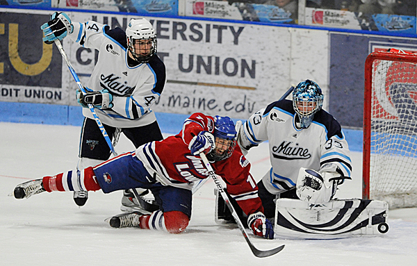 Ryan Hegarty (left) of the University of Maine returns to the lineup tonight as the Black Bears open at two-game series at Michigan State.