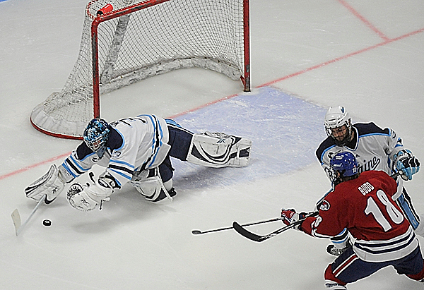U Maine goalie Dave Wilson makes a save in the first period of U Maine's third Hockey East quarterfinal series game with U Mass -Lowell at Alfond Arena Sunday night, March 14, 2010. (Bangor Daily News/John Clarke Russ)
