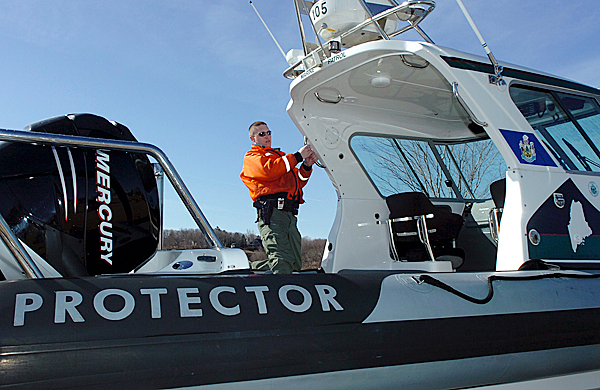 Marine Patrol Spc. Matt Talbot prepares to launch the Protector, a high-powered boat owned by the Department of Marine Resources, in Rockland Harbor on Tuesday, March 16, 2010. In light of the shootings on Matinicus Island, a bill being considered by the Maine Legislature would allow the Department of Marine Resources more leeway to close down fishing areas in order to protect public safety. BANGOR DAILY NEWS PHOTO BY BRIDGET BROWN