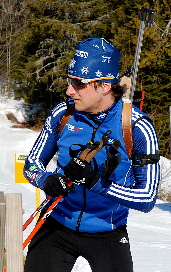 Stockholm's Russell Currier checks his time and scores during a training run at the 10th Mountain Lodge in Fort Kent this week. Currier, who trained with the Maine Winter Sports Center, is competing along with 80 other biathletes from around north America in the U.S. and North American Biathlon Championships which kicks off today. PHOTO BY JULIA BAYLY