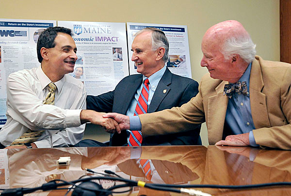 UMaine researcher Habib Dagher (from left), UMaine President Robert Kennedy and Allen Fernald are enthusiastic at the official announcement of an $8 million dollar grant to the development of offshore wind-power generation on Thursday.  BANGOR DAILY NEWS FILE PHOTO BY MICHAEL C. YORK