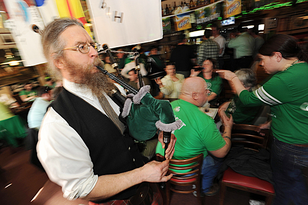 Bagpiper Peter Beckford entertains the crowd gathered at Geaghan's Pub in Bangor on St. Patrick's Day, Wednesday, March 17, 2010. A hat was passed as Beckford announced to the room that he plays for tips. BANGOR DAILY NEWS PHOTO BY KEVIN BENNETT