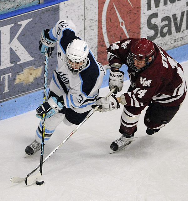 Joey Diamond (left) of the Univeristy of Maine battles for the puck with T.J. Syner of the University of Massachusetts during the first period Friday night at Alfond Arena in Orono. The Minutemen defeated the Black Bears 5-2.  (BANGOR DAILY NEWS PHOTO BY GABOR DEGRE)  CAPTION  The University of Maine's Joey Diamond (left) battles for the puck with T.J. Syner of the University of Massachusets during the first period of the game at the Alfond arena in Orono Friday.  BANGOR DAILY NEWS PHOTO BY GABOR DEGRE