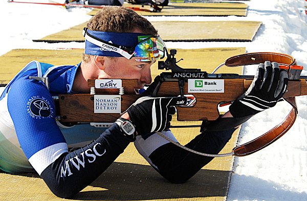 Maine Winter Sports Center biathlete Walt Shepard takes a shot from the prone position during Thursday's sprint competition at the North American Biathlon Championships in Fort Kent Shepard took second place in the event.  PHOTO BY JULIA BAYLY