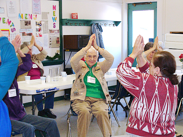 Judy Merck of Dover-Foxcroft, right, leads senior citizens through an exercise routine Thursday at the start of Senior Network in Dover-Foxcroft.  Facing Merck is Barbara Mitchell, 90,  of Dover-Foxcroft, who has been attending the twice weekly Senior Network since it was first offered more than two years ago. BANGOR DAILY NEWS PHOTO BY DIANA BOWLEY