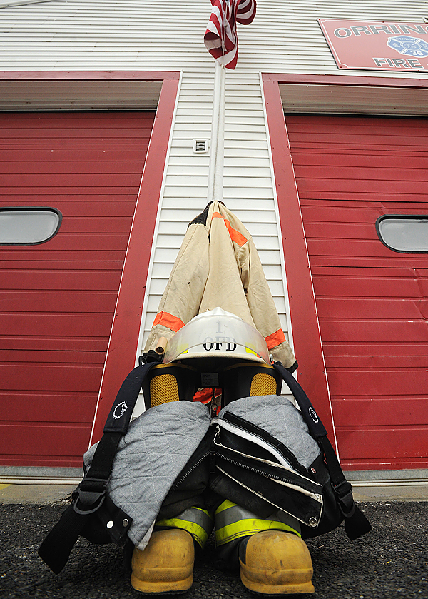 The turnout gear of former Orrington Fire Chief Leslie Grover was placed in the front of the firehous as a memorial to him Sunday.  Grover passed away over the weekend. BANGOR DAILY NEWS PHOTO BY GABOR DEGRE