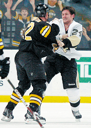 Boston Bruins' Shawn Thornton (22) fights with Pittsburgh Penguins' Matt Cooke (24) early in the the first period of an NHL hockey game Thursday, March 18, 2010, in Boston. (AP Photo/Mary Schwalm)