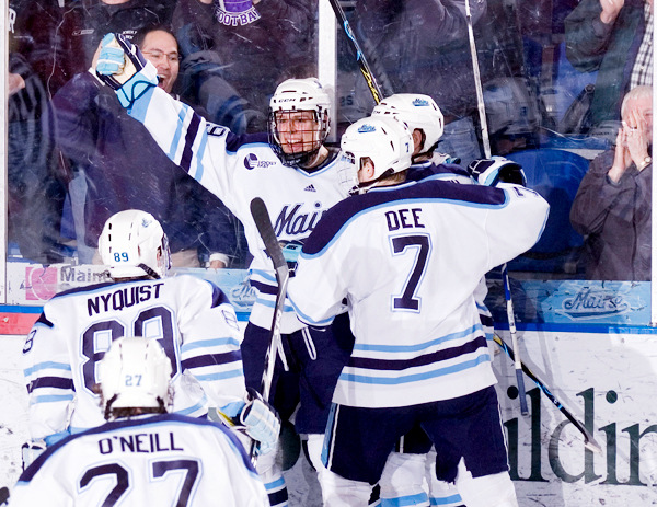 Maine's Tanner House (center) celebrates his goal with teammates Robbie Dee, Gustav Nyquist and Will O'Neill during an Hockey East quarterfinal game last March in Orono. The Bears have been picked to finish second in Hockey East in a preseason poll announced Wednesday during the league's media day in Boston.