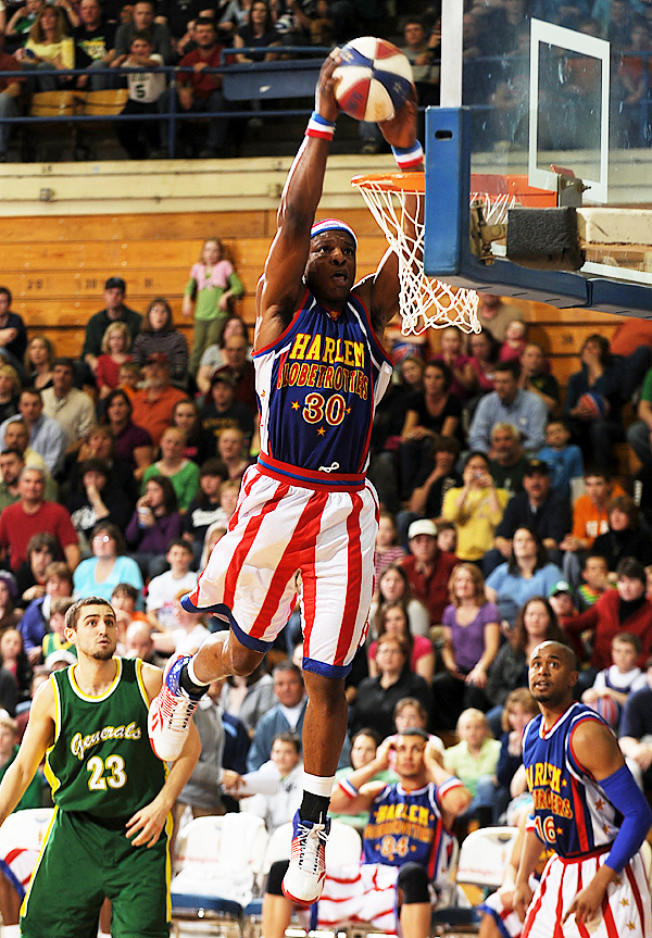 Harlem Globetrotter Sarge Johnson slams the ball throught the net at the Bangor Auditorium on Monday, March 22, 2010 while entertaining the crowd and beating the Washington Generals. (Bangor Daily News/Kevin Bennett)