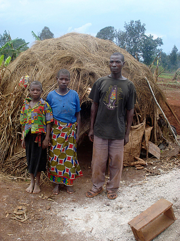 A Pygmy family in Muyinga, Burundi. Pygmies are the most marginalized people in Burundi, one of the world's poorest countries. The Pygmies of Muyinga historically inhabited vast rain forests, but when the forests were cut down, the Pygmies were left homeless in a modern world where their traditional ways of life were useless. Many Pygmies now live in makeshift homes, (like the one pictured above), made of cloth and tree branches. Oftentimes up to three families live in one of these shacks, enduring extreme poverty. Most Pygmies now work as day laborers or become street beggars. Pastor Ruben Ruganza, a refugee of the Democratic Republic of Congo, started an organization called FAMA to help the Pygmies of Muyinga. Since its founding, FAMA has helped educate Pygmy children, feed families and build Pygmies suitable housing. But astronomic amounts of work must still be done in order to help these displaced people.        (Photo courtesy of Pastor Ruben Ruganza)