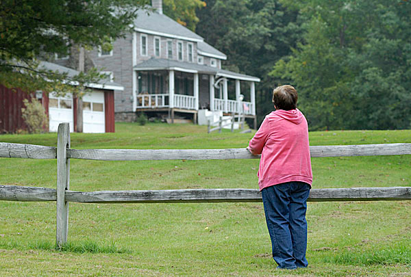 Janet Haiss looks over her parent's old farmhouse recently on Denman Mountain in Grahamsville, N.Y., where on May 25, 1955, her Freddie Holmes vanished. (Times Herald-Record Photo /MIKE RICE)