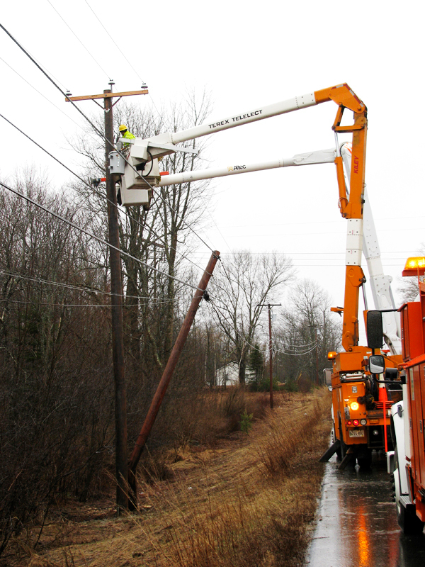 BELFAST - Central Maine Power linemen replace a utility pole that was snapped Tuesday afternoon in a single-vehicle accident on Route 3.   (Bangor Daily News/Abigail Curtis)