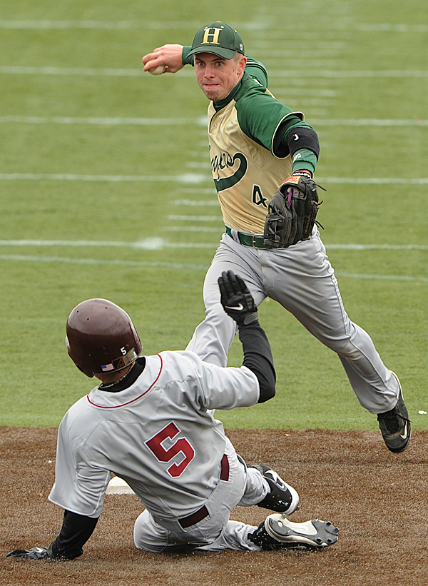 Husson's Adam Sheehan tags second getting Bates College runner Pat Murphy out as he looks to first to complete the double play during 3rd inning action of game one of a double header on Wednesday, March 24, 2010 at Husson University. BANGOR DAILY NEWS PHOTO BY KEVIN BENNETT