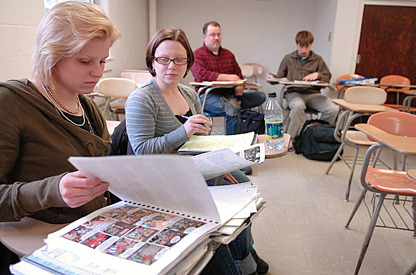 University of Maine students including (from left) Meaghann Fisher, Danielle Laliberte, Joe Garbowski and Ben Hewes participate in professor Kathryn Slott's French Translation and Comparative Stylistics class Wednesday afternoon, March 24, 2010 in Little Hall on campus. The school's Academic Program Prioritization Working Group released a report Wednesday outlining potential changes in order to reduce the academic program budget by more than $12 million. The proposed changes call for the reduction of undergraduate majors from 86 to 70 and 80 fewer faculty positions. French and other foreign language majors would be eliminated although courses in those languages would still be offered. BANGOR DAILY NEWS PHOTO BY BRIDGET BROWN