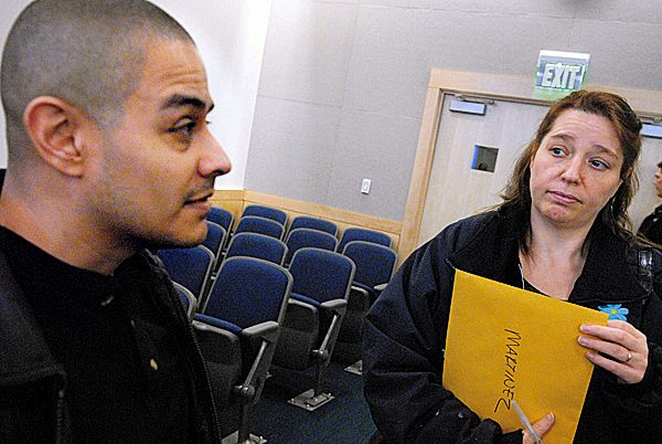 Abiel Martinez, left, and his wife, Bettyjo Martinez of Etna, talk with the BDN about their recent struggle to make their home mortgage payments. They attended a foreclosure diversion informational session with Justice Robert Murray and financial counselors at Penobscot Judicial Center Thursday afternoon, March 25, 2010. BANGOR DAILY NEWS PHOTO BY JOHN CLARKE RUSS