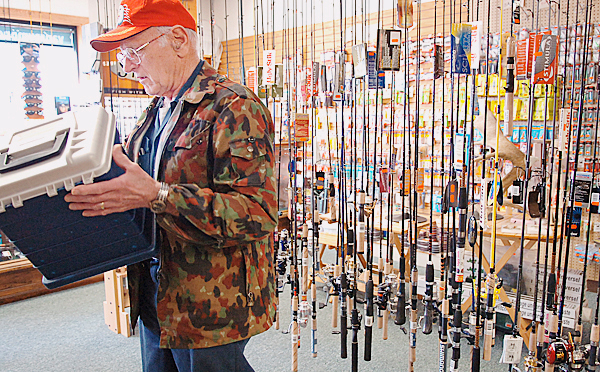 Albert Leach of Orland eyes a tackle box at Van Raymond Outfitters on Thursday, March 25, 2010 in Brewer, the day that Governor John Baldacci signed an emergency bill that allows freshwater recreational anglers to begin open-water fishing immediately. Traditionally, the opening day of open-water fishing on the state's lakes, ponds, streams and rivers is April 1. Though Leach wasn't going fishing Thursday, he did leave the store with a new tackle box and a few lures. &quotWhat good's a tacklebox without something in it?&quot Leach said. BANGOR DAILY NEWS PHOTO BY BRIDGET BROWN