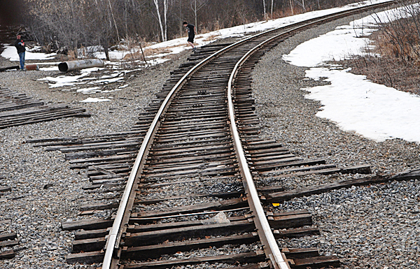 Rail ties of varied lengths on a Presque Isle section of the Montreal, Maine and Atlantic Railway in Presque Isle Thursday, March 18, 2010.  Safety concerns and poor track maintenance along sections of the MM&A railway in northern Maine limit the speed of their freight trains where 10 to 15 mph is common.  State officials are seeking a $25 million bond to repair rail in Aroostook, Penobscot and Androscoggin counties. Without such aid railways like MM&A might have to abandon their 241 miles of track which remain crucial to Maine industries.  BANGOR DAILY NEWS PHOTO BY JOHN CLARKE RUSS