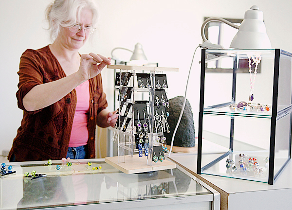 Jewelry artist Donna Tumosa, one of the four founding members of Jewelry Artisans of Maine, arranges earrings at the new Hampden store of the same name Wednesday, March 17, 2010. The store, which features hand-crafted jewelry by half a dozen local artists, is located on the Main Road in Hampden and open Monday through Saturday, 10 a.m. to 5 p.m.  BANGOR DAILY NEWS PHOTO BY BRIDGET BROWN