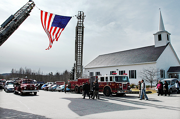 Family, friends and colleagues of Leslie &quotLes&quot Grover exit the East Orrington Congregational Church following a service Friday morning, March 26, 2010 to begin &quothis last ride&quot in the lead fire truck during a procession to Marston Cemetery in Orrington. Les was remembered for his long-time service to the community including 41 years at the fire department. BANGOR DAILY NEWS PHOTO BY BRIDGET BROWN