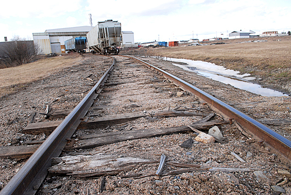 Splintered rail ties littered a section of track of of the Montreal, Maine and Atlantic railway near a depot for the Maine Potato Growers in Presque Isle Thursday, March 18, 2010.  Safety concerns and poor maintenance along sections of the MM&A railway in northern Maine limit the speed of their freight trains where 10 to 15 mph is common.  State officials are seeking a $25 million bond to repair rail in Aroostook, Penobscot and Androscoggin counties. Without such aid railways like MM&A might have to abandon their 241 miles of track which remain crucial to Maine industries. BANGOR DAILY NEWS PHOTO BY JOHN CLARKE RUSS