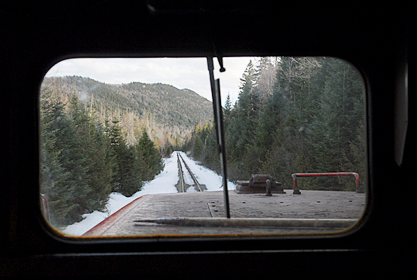 A scenic view of the Montreal, Maine and Atlantic railway seen through the front window of Engine 21 as the train approached Squapan Lake in T11 R4 WELS Thurdsday, March 18, 2010.  Safety concerns and poor maintenance along sections of the MM&A railway in northern Maine limit the speed of their freight trains where 10 to 15 mph is common.  State officials are seeking a $25 million bond to repair rail in Aroostook, Penobscot and Androscoggin counties. Without such aid railways like MM&A might have to abandon their 241 miles of track which remain crucial to Maine industries.  BANGOR DAILY NEWS PHOTO BY JOHN CLARKE RUSS
