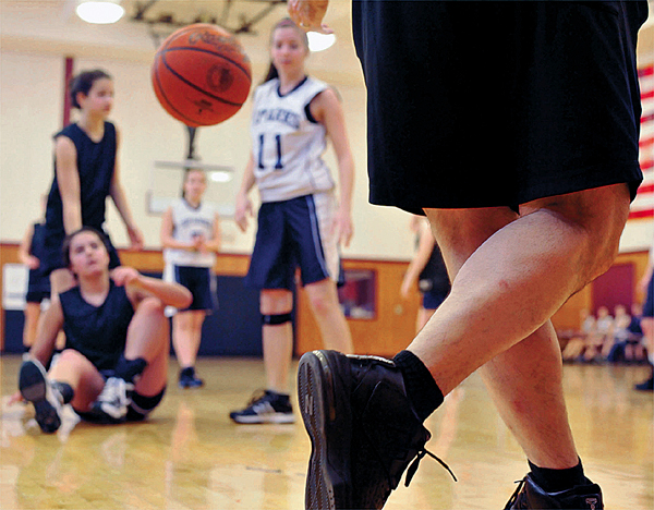 One of the first things that you notice about 'second season' basketball is that the officials wear shorts as here during a girls game at the former Pemetic High School in Southwest Harbor, Saturday, March 28, 2010.   BANGOR DAILY NEWS PHOTO BY MICHAEL C. YORK