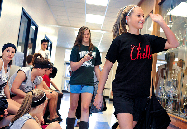 With so many teams playing, there is bound to be some congestion and confusion.  Taylor Border, right, from Camden Hills, followed by Abby Jewett, from MDI, pass the Waldoboro girls in the hallway of the fromer Pemetic High School, where they were putting on their sneakers and headbands Saturday, March 18, 2010.  BANGOR DAILY NEWS PHOTO BY MICHAEL C. YORK