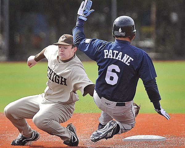 Maine's Tony Patane, (6), slides in to second base around Lehigh's Brendan McGaheran, (5), safe in the second inning of their game in Orono, Sunday, March 28, 2010. BANGOR DAILY NEWS PHOTO BY MICHAEL C. YORK