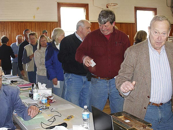 Castine residents cast their ballots during the annual town meeting on Saturday. BANGOR DAILY NEWS PHOTO BY RICH HEWITT