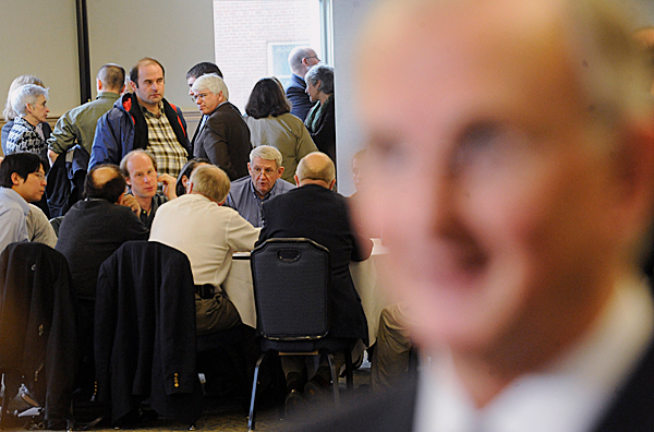 Members of the campus community form roundtable discussions as University of Maine President Robert Kennedy (foreground, right) talks with the media during Monday's information forum regarding the Academic Program Prioritization Group's recommendations. BANGOR DAILY NEWS PHOTO BY JOHN CLARKE RUSS