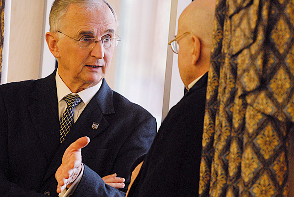 University of Maine President Robert Kennedy,left, talks with U Maine English professor Tony Brinkley during Monday's information forum on the Academic Program Prioritization Group's recommendations. BANGOR DAILY NEWS PHOTO BY JOHN CLARKE RUSS