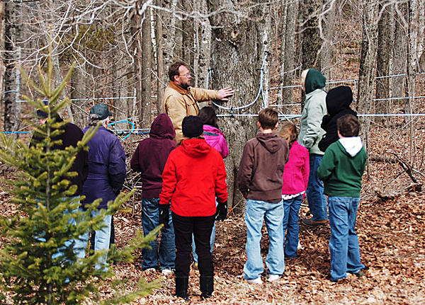 &quot We lost the sap run during those warm days, we just didn't get cold at night.&quot said Mike Hamblet as he explains the early start and early end to this years maple syrup season. Hamblet, shown here, at center, on Sunday, March 28, 2010  interested people how maple trees produce sap to be boiled down into maple syrup at  Wentworth Hill Farms in Knox during Maine Maple Sunday. BANGOR DAILY NEWS PHOTO BY KEVIN BENNETT