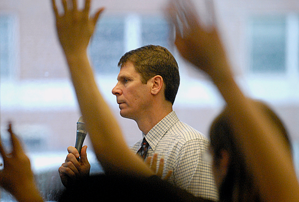 Many hands were raised and Jeffrey Hecker, Dean of the College Liberal Arts and Sciences, talked with concerned members of the campus community during Monday's information forum regarding the Academic Program Prioritization Group's recommendations. BANGOR DAILY NEWS PHOTO BY JOHN CLARKE RUSS
