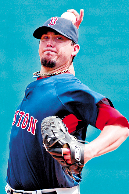 Boston Red Sox pitcher Josh Beckett warms up before the first inning of a spring training baseball game against the Pittsburgh Pirates in Bradenton, Fla., Wednesday, March 24, 2010.  (AP Photo/Gene J. Puskar)