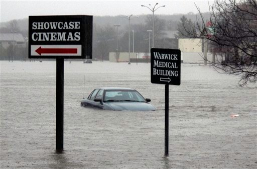 A car sits submerged in the parking lot of the Warwick Mall on Tuesday, March 30, 2010 in Warwick, R.I. The mall is adjacent to the Pawtuxet River which crested earlier in the day after heavy rainfall. (AP Photo/Joe Giblin)