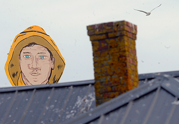 The Beach Cliff sardine fisherman sign towers over a rooftop Thursday, February 18, 2010 near the former Stinson Seafood plant in Prospect Harbor. Bumble Bee Foods announed Wednesday that it plans to close the plant for good in mid-April.  BANGOR DAILY NEWS FILE PHOTO BY JOHN CLARKE RUSS