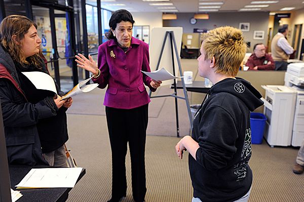 During her visit to Bangor Career Center Wednesday morning, Sen. Olympia Snowe (R-Maine) asks job seekers Christy Parker, left, and her friend Angelica Winn, right,  about their progress in finding work. Parker and Winn are both Bangor residents. Sen. Snowe also met with staff at the Center as well as other local officials to learn how the center and the region are addressing unemployment. BANGOR DAILY NEWS PHOTO BY JOHN CLARKE RUSS