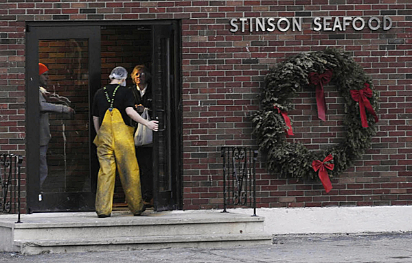 After taking a break late Thursday afternoon, an employee rejoins co-workers inside the former Stinson Seafood plant in Prospect Harbor. Workers there were notifed Wednesday by plant owner Bumble Bee Foods that the sardine cannery will close in April after being a fixture there for more than 100 years.  BANGOR DAILY NEWS FILE PHOTO BY JOHN CLARKE RUSS