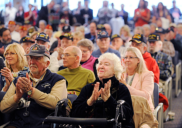 Maine Troop Greeters, including Louis Horvath and his wife Jeanne Horvath (in front row) of Holden applauded fellow servicemen during Bangor International Airport's &quotThanks A Million&quot Appreciation event recognizing their recent milestone of having greeted over one million troops. BANGOR DAILY NEWS PHOTO BY JOHN CLARKE RUSS