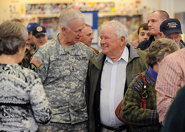 Major General John Libby,left , caught up with Maine Troop Greeter Jerry Mundy during the Maine Troop Greeters during Bangor International Airport's &quotThanks A Million&quot Appreciation event Wednesday, March 31, 2010. The event recognized their recent milestone of having greeted over one million troops. BANGOR DAILY NEWS PHOTO BY JOHN CLARKE RUSS