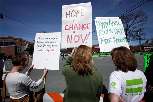 Protesters hold signs outside the Portland Expo prior to a visit by President Barack Obama, Thursday, April 1, 2010, in Portland, Maine. Obama is scheduled to deliver remarks on health insurance reform. (AP Photo/Robert F. Bukaty)