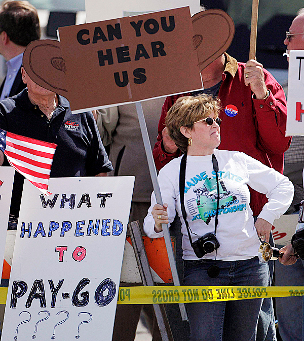 A protester holds a sign outside the Portland Expo prior to a visit by President Barack Obama, Thursday, April 1, 2010, in Portland, Maine. Obama is scheduled to deliver remarks on health insurance reform Thursday afternoon. (AP Photo/Robert F. Bukaty)