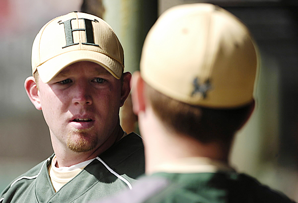 Husson University head baseball coach Jason Harvey talks with a team member during  game one of the team's home double-header against St. Joseph's College April 1, 2010. BANGOR DAILY NEWS PHOTO BY JOHN CLARKE RUSS