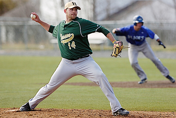 Husson University pitcher Dan Beatham winds up as St. Joseph College's Chris Campbell edges off first base during the fourth inning game one of Husson's  home double-header against St. Joseph's College April 1, 2010. BANGOR DAILY NEWS PHOTO BY JOHN CLARKE RUSS