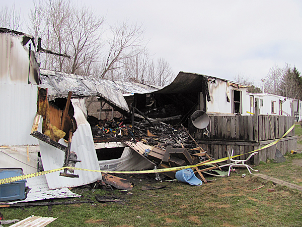 This mobile home at 61 Willow Lane in Newport was a total loss after a fire started near a furnace Thursday morning. The occupants, a mother and her two young sons, lost almost everything in the blaze. BANGOR DAILY NEWS PHOTO BY CHRISTOPHER COUSINS