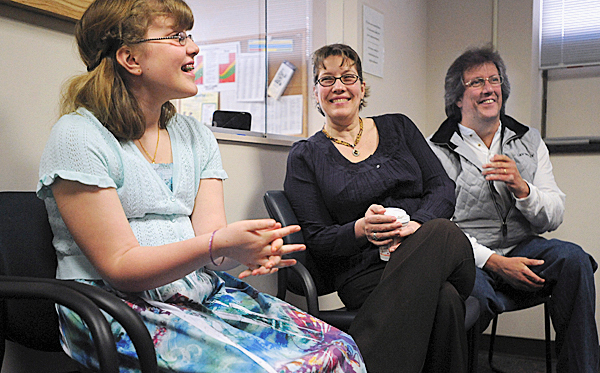 Haley Reynolds, 11, left shares a laugh with her parents, Kimm and Jeff Reynolds, during an interview at the Cutler Health Center at the University of Maine in Orono on Tuesda, March 16, 2010. BANGOR DAILY NEWS PHOTO BY GABOR DEGRE